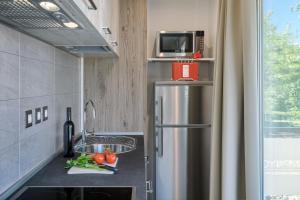 Kuchnia lub aneks kuchenny w obiekcie Mobile Homes - Lanterna Premium Camping Resort