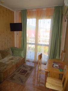 Гостиная зона в Гостевой Дом Мишель