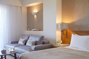 Ein Bett oder Betten in einem Zimmer der Unterkunft Minoa Palace Resort & Spa
