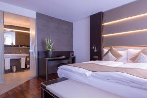 A bed or beds in a room at Hotel Krone Unterstrass