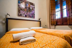 A bed or beds in a room at Nuevo Suizo