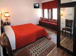 Ένα ή περισσότερα κρεβάτια σε δωμάτιο στο Ξενώνας Κωνσταντίνος Μπάκαρης