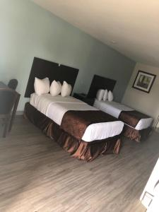 A bed or beds in a room at Cypress inn