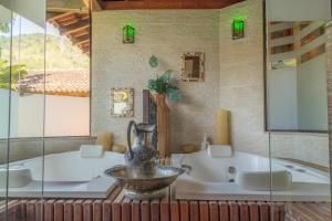 Um banheiro em Bomtempo Hotel Esporte & Lazer