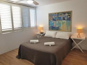 A bed or beds in a room at Casablanca Beachfront Apartments
