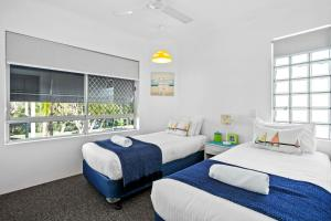 A bed or beds in a room at Noosa Riviera Resort