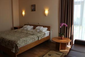 Кровать или кровати в номере Гостиница Академическая