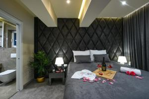 A bed or beds in a room at Luxury Rooms LaVie