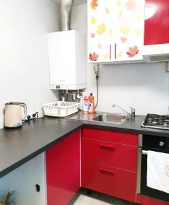 A kitchen or kitchenette at Апартаменты на 26 июня
