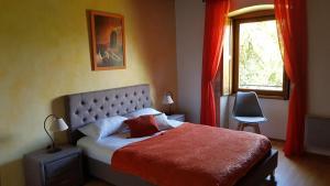 Un ou plusieurs lits dans un hébergement de l'établissement Auberge du Vernay