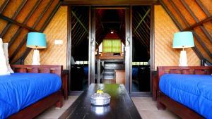 Llit o llits en una habitació de Istana Balian