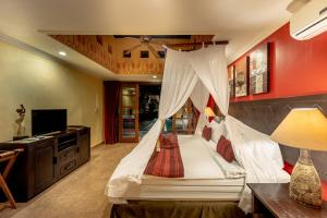 A bed or beds in a room at Bidadari Private Villas & Retreat
