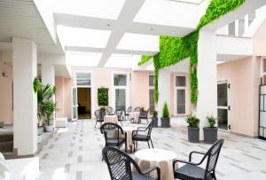 Restaurant ou autre lieu de restauration dans l'établissement iH Hotels Roma Dei Borgia