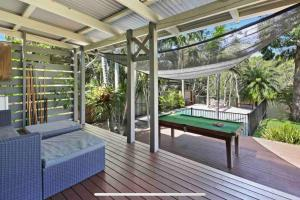 A pool table at Lakeside Beach House - Hostie Properties
