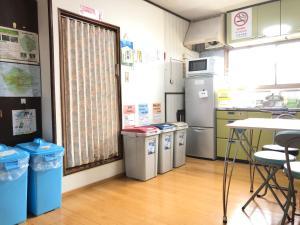 A kitchen or kitchenette at Minshuku Kaisei 1
