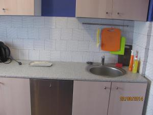A kitchen or kitchenette at Apartments at Leningradskaya