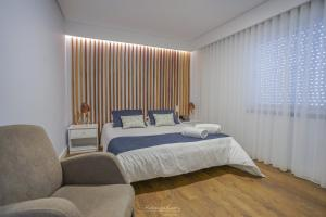 Uma cama ou camas num quarto em Hotel Teresinha