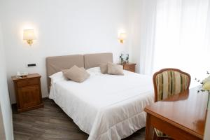 A bed or beds in a room at Resort Sant'Angelo & SPA