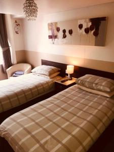 A bed or beds in a room at Spalite Hotel
