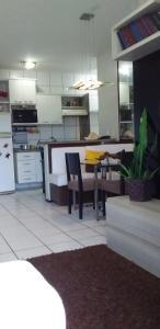A kitchen or kitchenette at Apartamento Fortaleza.