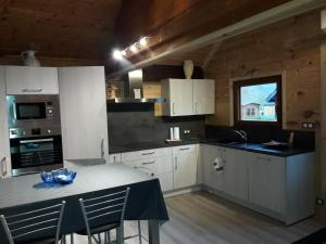 A kitchen or kitchenette at Domaine du Hulobiet