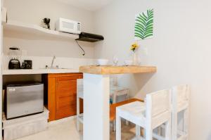 Una cocina o zona de cocina en Rentalife Playa