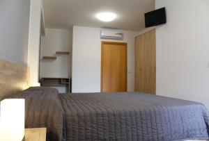 A bed or beds in a room at Bed Ponente