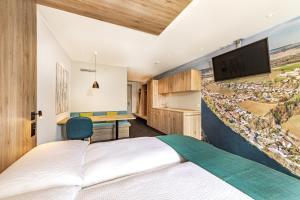 Ein Bett oder Betten in einem Zimmer der Unterkunft Hotel sleep&stay