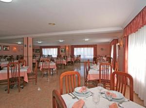 Un restaurante o sitio para comer en Hotel Pipo