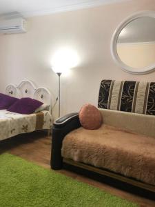 Гостиная зона в Апартаменты Зорге - Благодатная