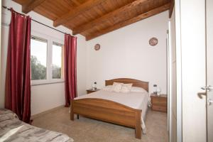 A bed or beds in a room at Casa vacanze kitesurf Apt 1 - Gli Ulivi