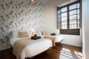 Cama o camas de una habitación en Holidays2Malaga Premium Old Town