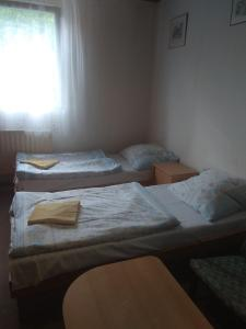 A bed or beds in a room at Smolné Pece