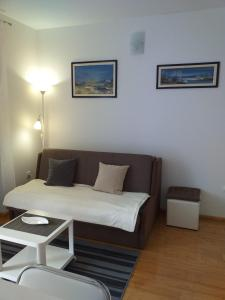 A seating area at Apartman Bruna