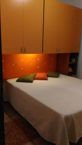 A bed or beds in a room at Villino Marmora