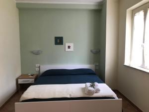 Letto o letti in una camera di B&B Villa degli Ulivi
