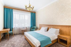 Кровать или кровати в номере Zolotaya 7 Hotel Domodedovo