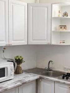 A kitchen or kitchenette at La Provence Appt. No. 1
