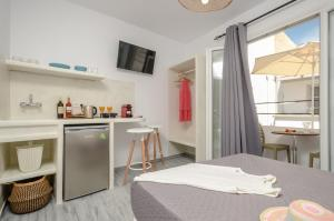 A kitchen or kitchenette at Prestige on the beach