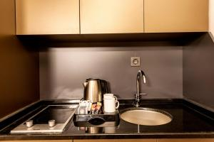 A kitchen or kitchenette at A Palace Suites
