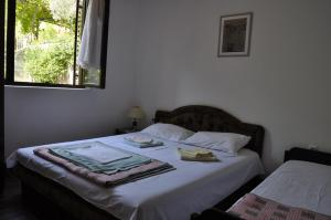 A bed or beds in a room at Apartmani Novakovic