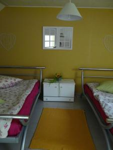 A bed or beds in a room at Ten Huize Peckeneck