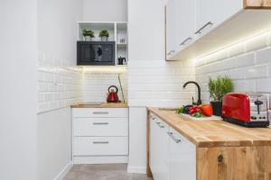 Kuchyňa alebo kuchynka v ubytovaní Liv Apartments Old Town