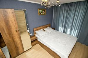 A bed or beds in a room at Orbi bakuriani aparthotel 905
