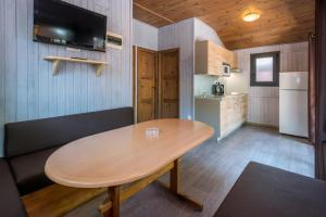 A television and/or entertainment centre at Camping Solmar