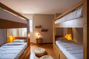 A bunk bed or bunk beds in a room at Being Porto Hostel