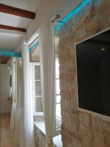 A television and/or entertainment centre at Apartments & Rooms Trogir Stars