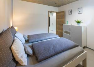 Postel nebo postele na pokoji v ubytování Nerudovka apartment