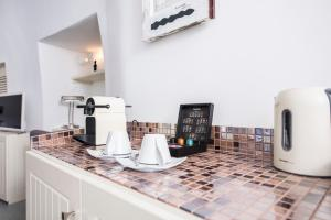 Cuisine ou kitchenette dans l'établissement Ambition Suites