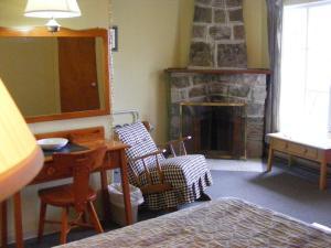 Coin salon dans l'établissement Hotel Motel Bon Accueil